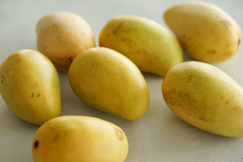 Mangoes on white table top