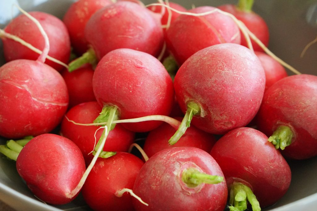 Close up of fresh radishes in a bowl