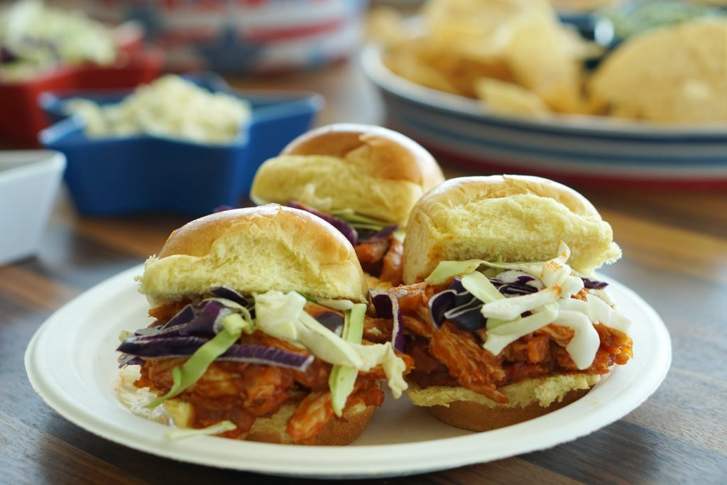 Plate of Smoky Maple BBQ Chicken Sliders with party fare
