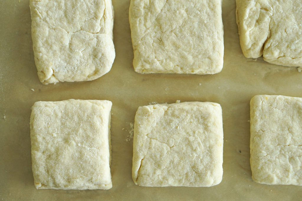 Buttermilk shortcakes on parchment ready to be baked