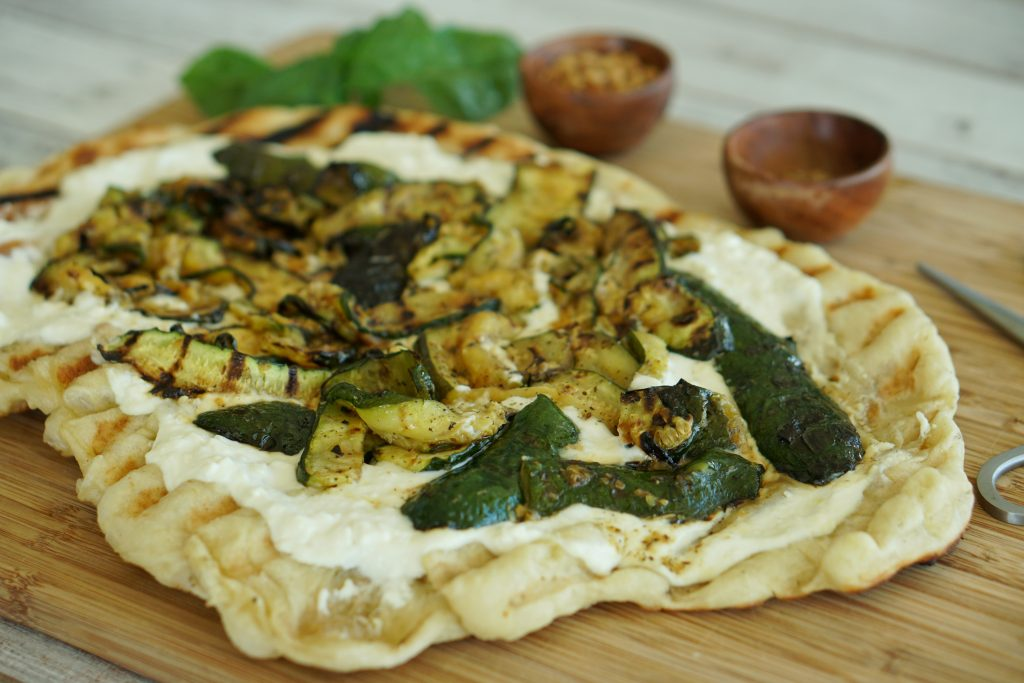 Grilled Zucchini Pizza with Ricotta & Feta on cutting board