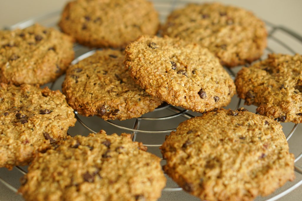 Oatmeal Chocolate Chip Breakfast Cookies piled on a cooling rack